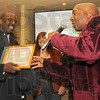 Welcome: Jerome Cheatham accepts his certificate from friend and fellow musician Archie Smith. Cheatham and 14 others were inducted into the Wabash Valley Musicians Hall of Fame in a Sunday afternoon ceremony. In the background is Vikki Scott, also and inductee.