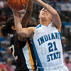 Tribune-Star/Joseph C. Garza<br /> Muscling her way through: Indiana State's Amanda Pedro fights past a Wichita defender on her way to the basket during the Sycamores' 81-59 win Sunday at Hulman Center.