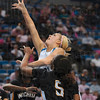 Tribune-Star/Joseph C. Garza<br /> Through heavy traffic: Indiana State's Amanda Pedro drives to the basket between two Wichita State defenders Sunday at Hulman Center.
