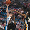 Tribune-Star/Joseph C. Garza<br /> Scoring leader: Indiana State's Kelsey Luna shoots over two Wichita State defenders during the Sycamores' 81-59 win Sunday at Hulman Center. Luna led all scorers with 24 points.