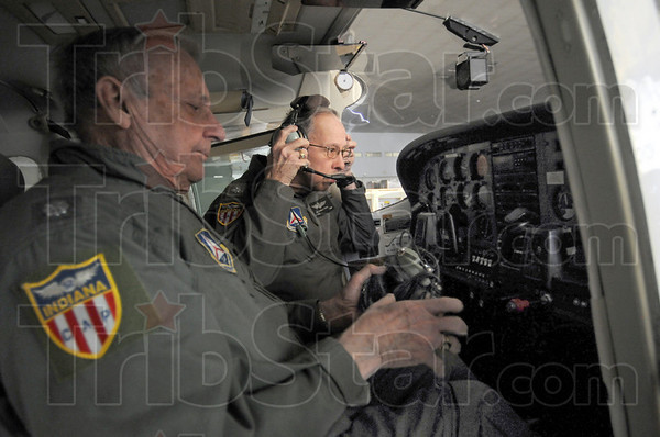 Cockpit: Lt. Colonel Tom Picket and Lt. Colonel Reginald Paul in the cockpit of their Civil Air Patrol aircraft Sunday afternoon in a hangar at Hulman Field.