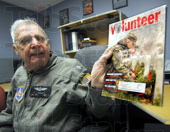 Magazine: Lt. Colonel Tom Picket holds a copy of the Civil Air Patrol Volunteer magazine that featured the Great Lakes Region's counter drug program.