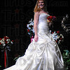 Now showing: Jessica Baxter models a gown with a moderate train at the Tribune-Star Bridal Show.