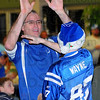 Oh yeah: Drew Gehman and his son Samuel exchange high 5s during the first half of the Colts-Saints game Sunday evening. They and about 200 other members of Maryland Community Church remained after Sunday evening services to watch the game.