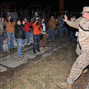 I'm back: One of the 170 returning Marines of Kilo Company waves to family and friends as he leaves the bus that brought him to the reserve center on Fruitridge Avenue.