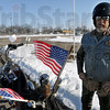 Let's roll: Legion rider Todd Pierson braved the cold weather to ride his motorcycle in support of the returning Marine unit.