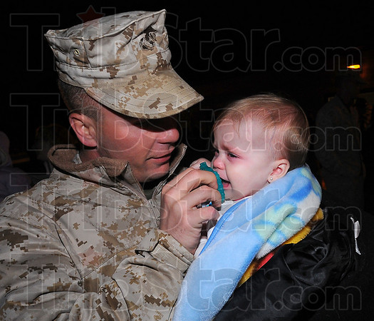 Fathers touch: Corporal Jack Forshee comforts his 11 month old daughter Meigha shortly after his arrival back from his tour of duty in Iraq with Kilo Company.