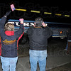 They're home: Two family members wave to their Marine as the busses pull up to the reserve center on Fruitridge late Friday night.