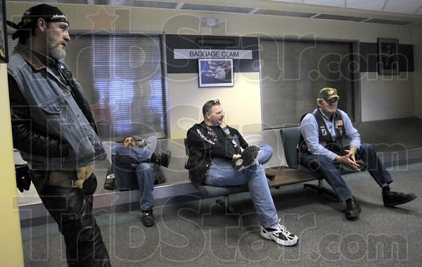 Waiting game: Legion riders Todd Pierson, Jim Hamby, Randy Blake and John Abel wait for the Marines to land Friday evening at Hulman International Airport.