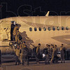 The Marines have landed: Members of Kilo Company, 3rd Battalion, 24th Marine Regiment unload at Hulman International Airport Friday evening at about 8:55 p.m.