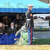 Flag folding: Two Marines fold the flag from the casket of Cpl. Gregory Stultz Friday afternoon as family members watch during a graveside service Friday afternoon.