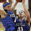 Rebound: Rockville's #41, Drew Kelley grabs a rebound away from #4, Copdy Jeffries during game action against Terre Haute South Friday night.