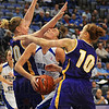 Inside game: Sycamore Shannon Thomas tries to get to the hoop throught the defense of Panthers Lizzie Boeck(20) and Jacqui Kalin(10).