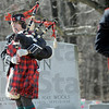 Piper: A piper plays as a Marine Honor Guard carries the casket of Cpl. Gregory Stults to its final resting place Friday afternoon.