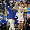 "Three ball: Rockville coach Dave Mahurin appears to signal a ""three"" as South's #34, Jacob Tanoos launches and hits the shot during first half action Friday evening."