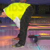Getting it done: Rick Burger of Duke Energy makes a spare an unconventional way at the Wabash Valley Crime Stoppers' Strike Out Crime event Friday afternoon at the Terre Haute Bowling Center.