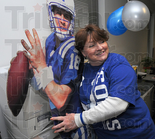 Two dimensional QB: VCSC employee Sharon Beeson mugs with a lifesize cutout of Indianapolis Colts quarterback Peyton manning . Most of the administration building for the school corporation went Colts Blue Friday.