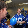 Colts bling: Vigo County School Corporation  employee Jenny Thomas sports blue horseshoe earrings Friday afternoon while she talks with fellow workers Christi Fenton and Connie DeGroote.