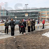 "Evacuated: Union Hospital employees wait for the ""all clear"" to return to work after a bomb threat Satuday afternoon."