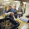 Service: Kristin Sutliff, Paula Pierce and Keith Ruble serve pancakes and sausage breakfasts to customers at Fowler Park Saturday morning.