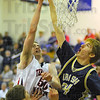 Challenged: Justin Gant hs his shot deflected by Cathedral forward Kevin Owens. Gant was fouled on the play and made both free throws.