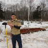 Job well done: Aaron Hoogenboom poses in front of  his Eagle Scout project Saturday afternoon. He and several friends, fellow scouts and family members put in about 90-100 hours installing the flower bed and flag pole in the cemetery of the Lamb of God Church in Southern Vigo County. Donations for the project came from several sources including the township trustees office.