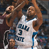 Tribune-Star/Joseph C. Garza<br /> Up for grabs: Indiana State's Rashad Reed reaches for a loose ball against Missouri State's Nafis Ricks during the Sycamores' win Saturday at Hulman Center.