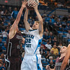 Tribune-Star/Joseph C. Garza<br /> Workin' it into the inside: Indiana State's Aaron Carter drives to the basket against Missouri State's Will Creekmore during the Sycamore's 75-72 overtime win Saturday at Hulman Center.