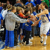 Crowd favorite: Kelsey Lina makes the rounds in the Sycamores pre-game ritual Friday evening.