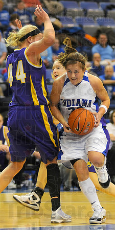 Bringing it: Kelsey Luna works against the defense of Northern Iowas' Erin Brocka in first half action Friday night.
