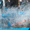 "Tribune-Star/Joseph C. Garza<br /> Soaked sequence: Indiana State sophomore Ben ""Billy Bob"" Rice, 19, of Borden, plummets from the top of a small pool ladder to make a big splash during the Polar Plunge Saturday outside of Hulman Center."