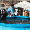Tribune-Star/Joseph C. Garza<br /> Polar cannonball: A participant in the Polar Plunge tucks her legs under for an even larger splash outside of Hulman Center Saturday.