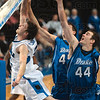 Tribune-Star/Joseph C. Garza<br /> Driving through: Indiana State's Aaron Carter drives against Drake's Adam Templeton (44) and Seth VanDeest during the Sycamores' win Saturday at Hulman Center.