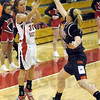 Not this time: Terre Haute North's #4, Mary Kate Etling jumps out to block the shot of South's #30, Emily Bell during first half action Wednesday evening. Bell, just moments before hit a three-point-shot from the exact location.