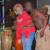 Participation: Ivy Tech State College nursing student Sherri Vest tries to keep a straight fcce while on stage with Justo Asikoye of Jabali Afrika. The group blends modern and traditionl instruments and sounds to go along with their original choreography.