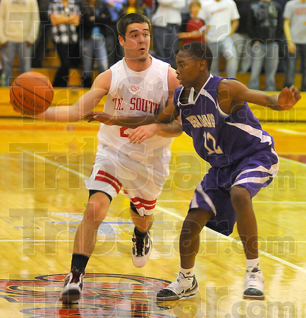 Tight defense: Bryn Schwartz gets a pass off past the defense of Ben Davis guard Dorian Dowdell.
