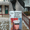 Tribune-Star/Joseph C. Garza<br /> An American hero: Signs, like this one, are posted on light poles and businesses to remember the late Marine Cpl. Gregory Stultz in Brazil.