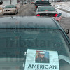 Tribune-Star/Joseph C. Garza<br /> Hometown hero: A motorist displays the poster of the late Marine Cpl. Gregory Stultz in his back window Wednesday in Brazil.