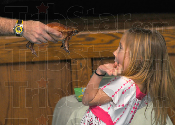 Safe distance: JoDee Barnes recoils from Amazon John's flat-sided toad during his Silly Safari presentation Wednesday afternoon at Ouabache Elementary School.