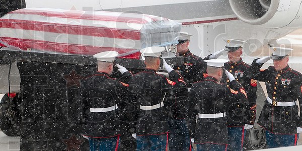 Tribune-Star/Joseph C. Garza<br /> Rendering honors: A Marine Corps honor guard renders a hand salute as the casket of the late Marine Cpl. Gregory Stultz is loaded off of a plane Wednesday at the Terre Haute International Airport-Hulman Field.