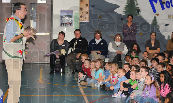 Maggies favorite: Amazon John presents a rabbit, Maggie Vicorys favorite animal, during his Silly Safari presentation at Ouabache Elementary School. Maggies parents, Linda and Michael are in the background with her aunt Dede Rhemel and grandmother Susan Vicory.