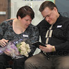 Memento: Linda and Michael Vicory looks at a CD made for them by Ouabache Elementary School. That and the flowers were presented during a Wednesday program done in honor of their daughter Maggie who died in a car accident.
