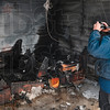 Tribune-Star/Joseph C. Garza<br /> Investigative photography: Sugar Creek Fire Department Capt. Matt Holbert takes a photo of one of the burned out storage containers at Viking Storage Monday in West Terre Haute.