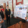Going green: Rose-Hulman Institute of Technology students presented sustainability ideas in Hadley Hall on campus Monday. Here Keegan Superville, right, and Jose Lujan talk about converting to a geothermal system for Moench Hall, Hulman Union and the Sports Recreation Center. Also addressed were green hand dryers, window sensors and storm water management.