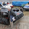 Loading: Neoteric President Chris Fitzgerald (with clipboard) and employees Jeff Short (L) and Eric Walin load the first of six hovercraft that will be shipped to Mumbai, India for the 2010 Cricket World Championship.