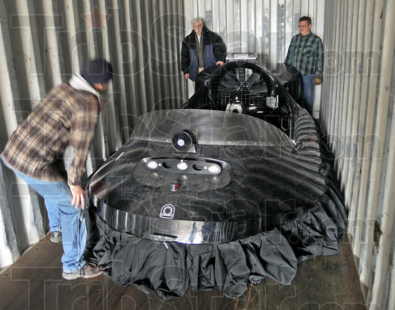 Tight: Neoteric Hovercraft employees load a hovercraft into a 40 ft. shipping container to begin thier long journey by truck, rail and seat to India.