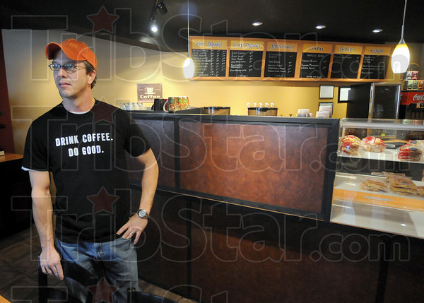 Do gooder: Abraham LaVoi talks with Tribune-Star reporter Arthur Foulkes about the re-opening of his coffee shop Tuesday afternoon.