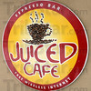 Logo: Detail photo of Juiced Cafe signage.
