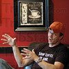 Drink coffee...do good: Abraham LaVoi talks about the re-opening of the Juiced Cafe Tuesday afternoon.