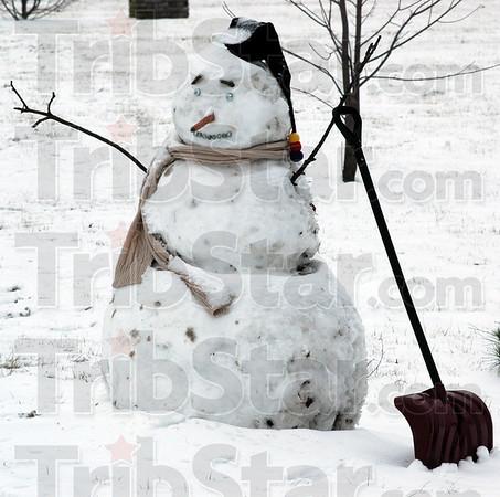 Snowman: A snowman stands along Davis Avenue near Rea Park Tuesday morning.